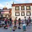 Stock Photo: Tibet, Lhasa, Buddhists make prostration (pray) before first Buddhist temple in Tibet, Jokhang