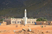 People play football next to the mosque, Sokotra — Stock Photo
