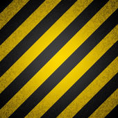 Vector background - black and yellow hazard stripes — Stock Vector
