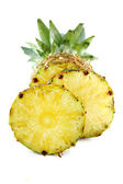 Ripe pineapple with slices — Stock Photo