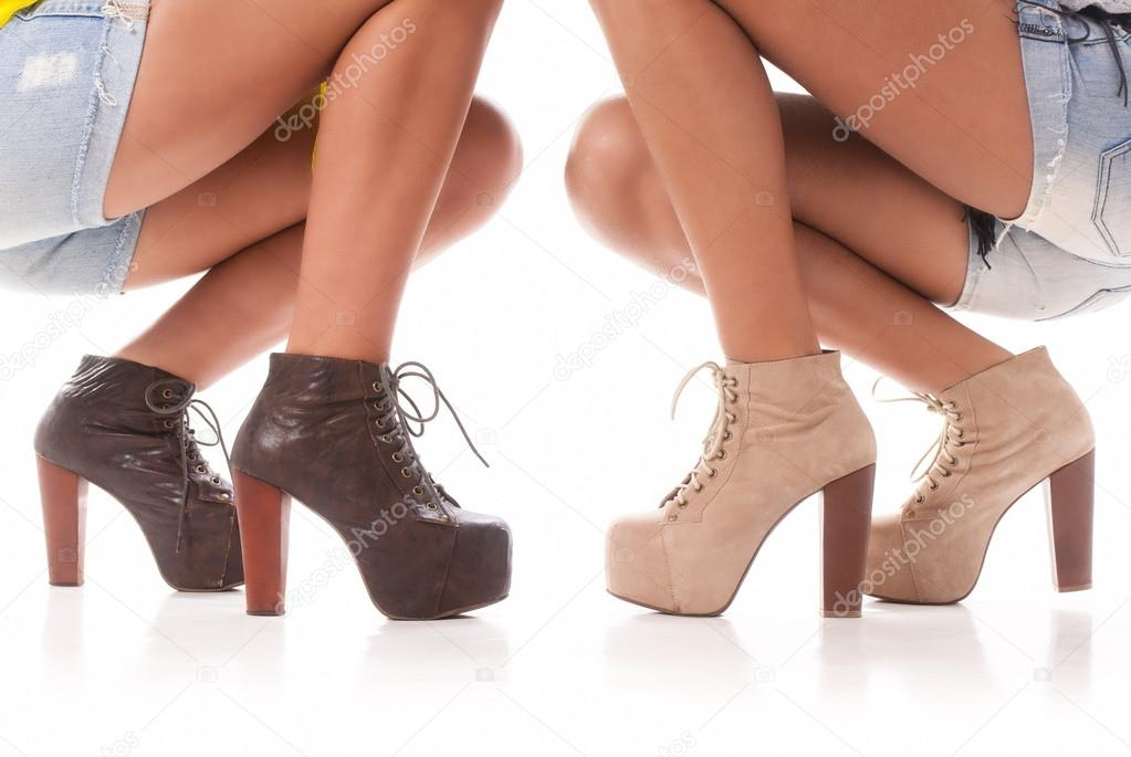 Two isolated pair of woman legs and ass with fashion shoes on white background — Stockfoto #14880799