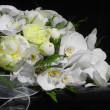 Stock Photo: Wedding bouquet on black piano