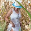 Woman in corn field — Stock Photo