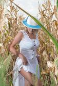 Woman in corn field — Stock Photo