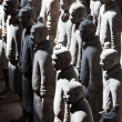 Terracotta warriors lit by sun light — Stock Photo