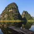 Stock Photo: Limestone hills and raft at Li river