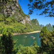 Stock Photo: Li river with limestone rocks on sides