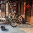 Traditional chinese street view with bikes — Stock Photo