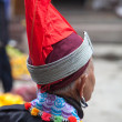 Woman with a traditional red Chinese tribal hat — Stock Photo
