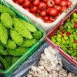 Vegetables in baskets at a market — Stock Photo