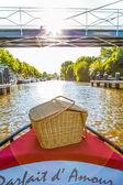 Picnic boat floating under a bridge — Stock Photo