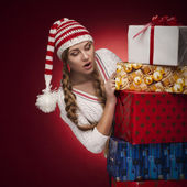 Women with Santa hat with presents isolated — Stock Photo