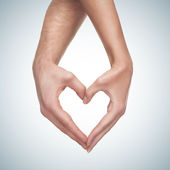 Hands show heart gesture — Stock Photo