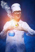 Young chemist makes the experience — Stock Photo