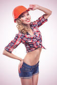 Young pinup woman with hardhat isolated — Stock Photo