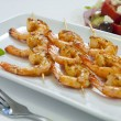 Chili prawn skewers with greek salad - Stock Photo