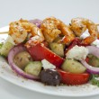 Greek salad with chili shrimps — Stock Photo