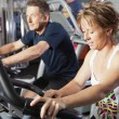 Stock Photo: Mature couple at fitness centre
