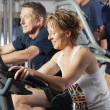 Mature couple at fitness centre - Stock Photo