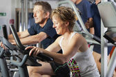 Mature couple at fitness centre — Stock Photo
