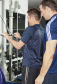 Senior male and PT at the fitness centre — Stock Photo