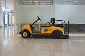 Disabled buggy in airport — Stock Photo