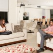 Couple in living room — Stock Photo #22925514