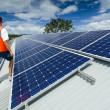 Solar panels on factory roof — Stock Photo #22942976