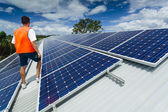 Solar panels on factory roof — Stock Photo