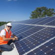 Solar panels with technician — Stock Photo #24706131