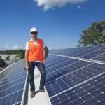 Solar panels with technician — Stock Photo #24706141