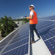 Stock Photo: Solar panels with technician