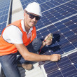 Solar panels with technician — Stock Photo #24706235