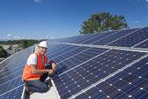 Solar panels with technician — Стоковое фото