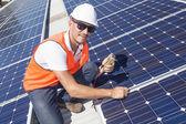 Solar panels with technician — Stock Photo