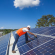 Solar panels with technician — Stock Photo #29078723