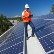 Solar panels with technician — Foto de Stock