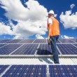 Solar panels with technician — Stock Photo #29079179