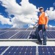 Solar panels with technician — ストック写真
