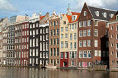 Old houses along a canal (gracht) in the center of Amsterdam - H — Stock Photo