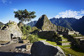 Sunrise at Machu Picchu with the Huayna Picchu in the background - Peru