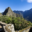 Ruins of the old lost Inca city Machu Picchu in Peru - South America - Stock Photo