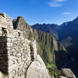Ruins of the old lost Inca city Machu Picchu in Peru - South America — ストック写真