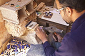 A craftsman makes tiles for a mosaic in Morocco - North Africa — Stock Photo
