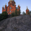 Facade of the Uspenski Cathedral in Helsinki - Finland in the red evening sunlight in the Summer. — Stock Photo