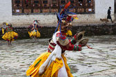 Monks dance in costumes during the Ura Tsechu Festival in Bumthang Valley in Bhutan — Stock Photo