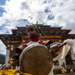Постер, плакат: Monks dancing at the Tchechu festival in Ura Bumthang Valley in Bhutan