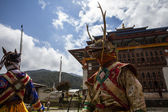 Monks dancing at the Tchechu festival in Ura - Bumthang Valley in Bhutan — Stockfoto