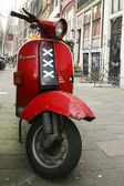Red scooter in Amsterdam - The Netherlands — Stockfoto