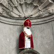 Manneken Pis in Sinterklaas clothes - Brussels - Belgium — Stock Photo